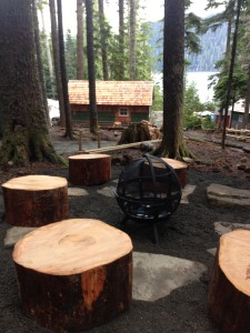 Campfire area with cabin in background